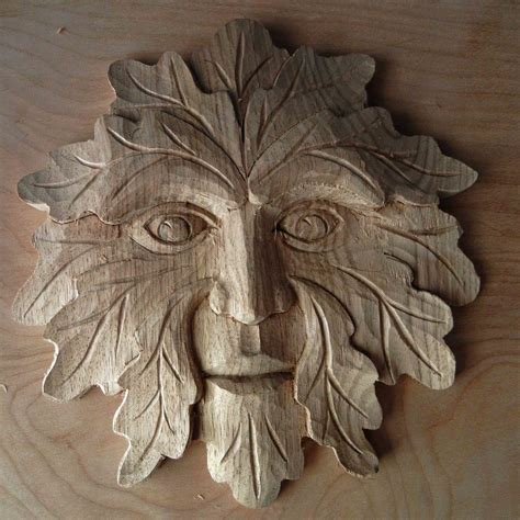 intro  woodcarving  green man  mary