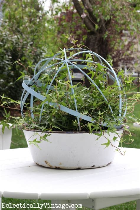 make topiary forms from garden orbs