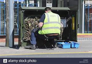 Telecom Workman Working On Street Telephone Junction Box