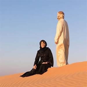 Couple Dressed In Traditional Arab Clothing In Desert ...