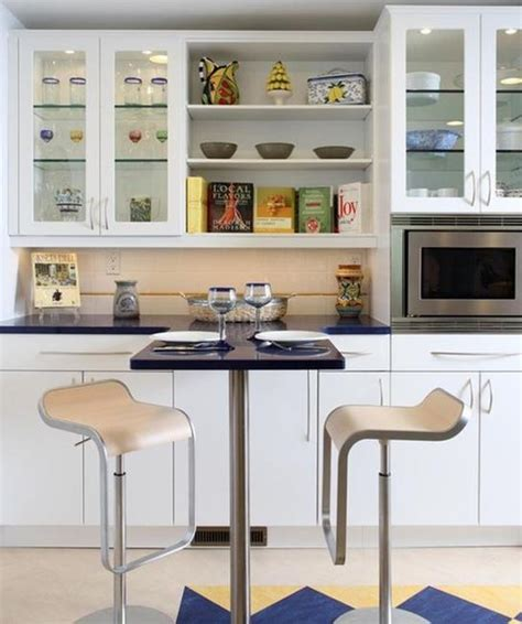 Kitchen Cabinets With Glasses by Decorating With Glass Cabinets Doors Brings Light Into