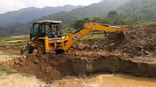 backhoe digging  hole excavator  big