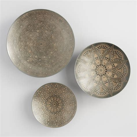 The bright, starburst design creates a reflective display. Zinc and Gold Metal Etched Disc Wall Art Set of 3 by World ...