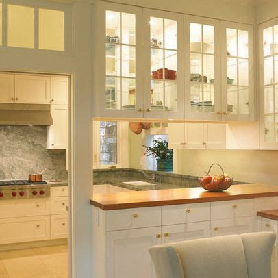 kitchens with wood floors galley kitchen with bar separating dining room design 8786