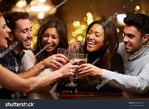 Group Friends Enjoying Evening Drinks Bar Stock Photo 238694317 - Shutterstock