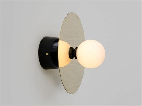 buy the atelier areti disc and sphere wall light at nest co uk