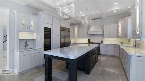 white kitchen cabinets   dark grey island omega