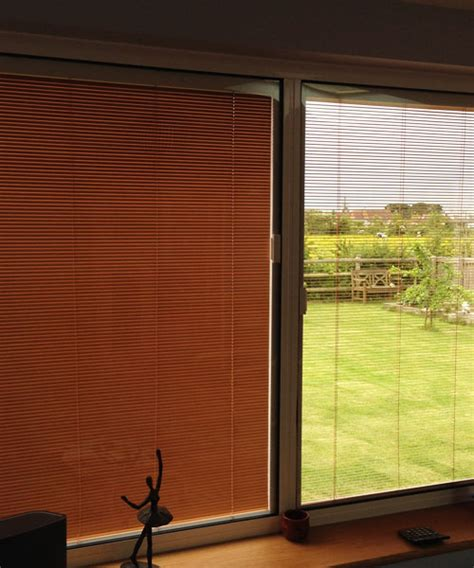 windows with blinds between the glass glazing with integral blinds in keepout windows