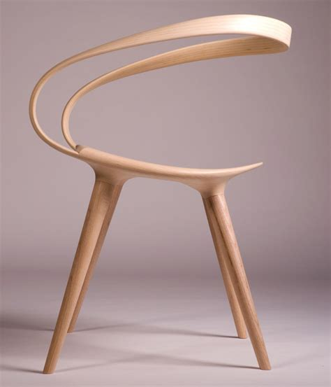 chaise designe the velo chair uses a single of bent wood as the