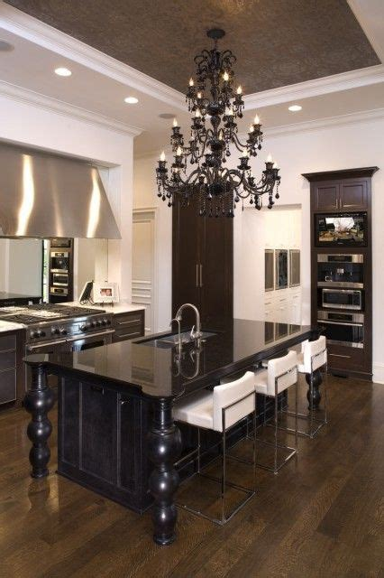Black Chandelier Kitchen kitchen with simple lines offset by a fancy black