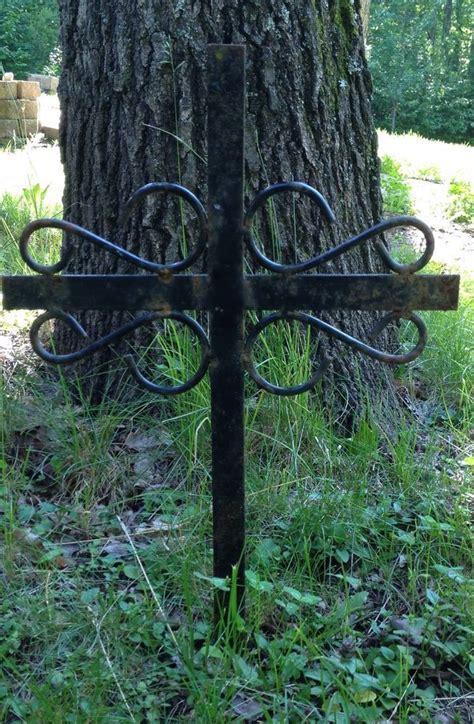 black metal cross    rusty patina scrollwork
