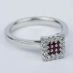 ruby and cluster engagement ring in platinum