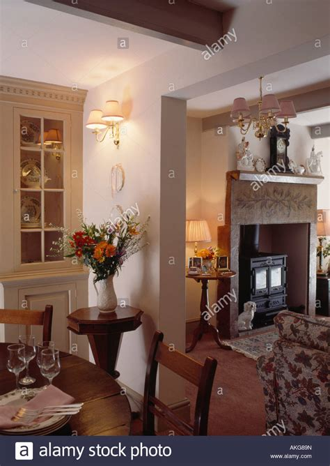 wall lights in small dining room with open doorway to
