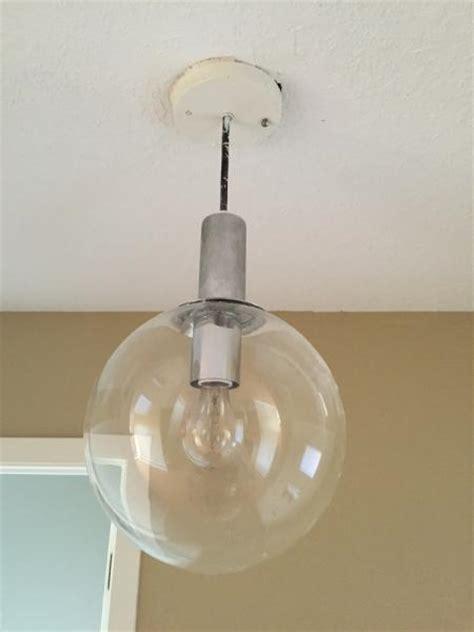 how do i remove globe to change bulb doityourself