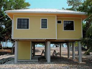 Small Elevated Beach House Plans with Pilings — Farmhouse