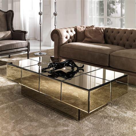 The washed light brown finish adds depth to its distressed plank wood texture, transmuting your setting into a casual space. Italian Designer Bronze Glass Storage Coffee Table