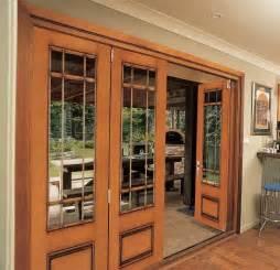 jeld wen mahogany woodgrain fiberglass folding patio door system antique honey finish