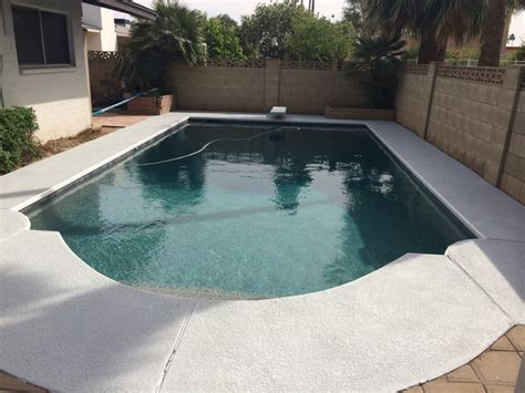 after the pool was finished pebble tec water line tile