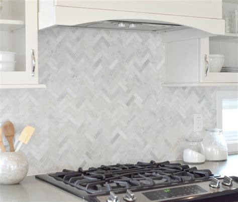 marble chevron cooktop backsplash with glass front kitchen