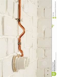A Vintage Outlet And Electrical Wiring In A Copper Tube