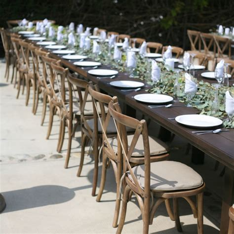 cross  wood chairs party  wedding rentals