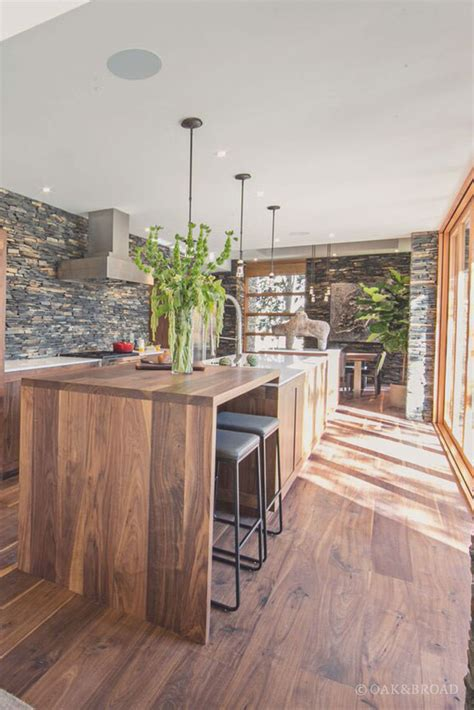 stunning contemporary home  wide plank black walnut floor