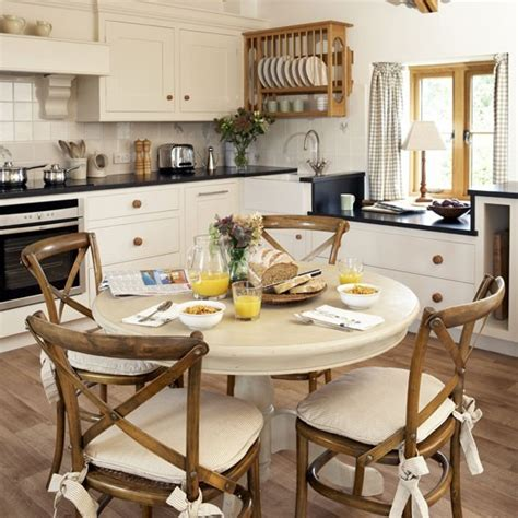 Countrystyle Family Kitchen With Round Table Family