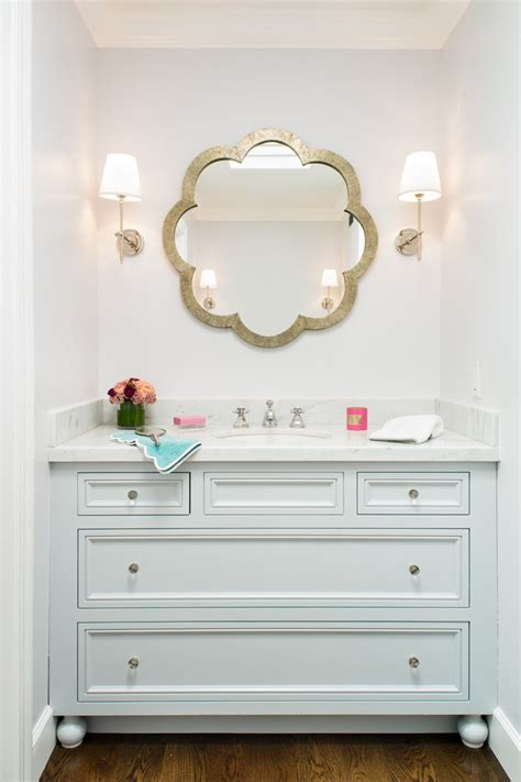 framed bathroom mirrors with skylights wood cabinets