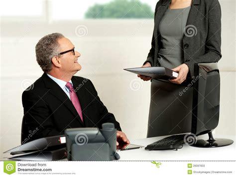 smiling aged male boss   secretary stock