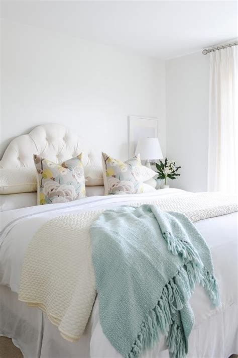 pastel color pillows  white curved headboard