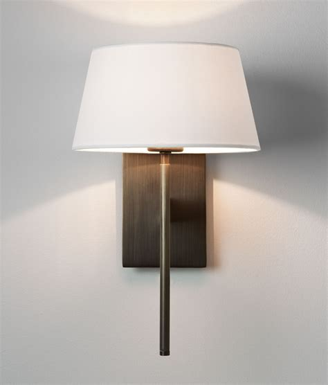 wall light with fabric shade is available in three