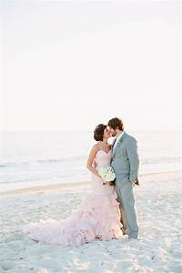 blush wedding dress on the beach best wedding blog With blush beach wedding dress