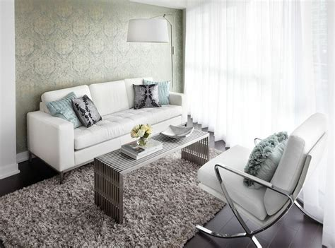 Chrome Overhanging Floor L by Contemporary Condo Living Room With White Leather Sofa