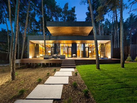 inspired by the forest modern chalet in poltava unveils refined serenity