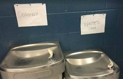 whites   colored signs taped  school water