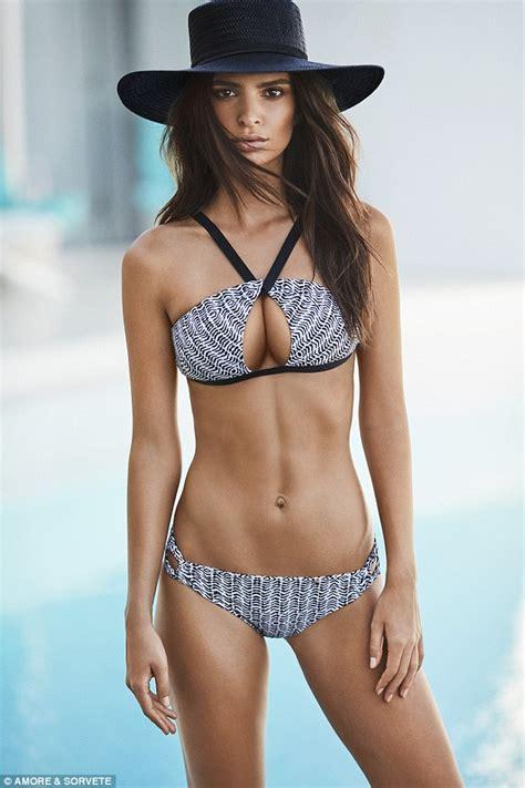 Emily Ratajkowski wears a range of skimpy bikinis as she ...