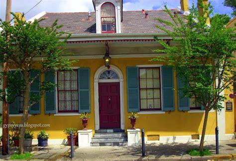 mustard yellow turquoise shutters burgundy door nola n o l a b e a u t y exterior
