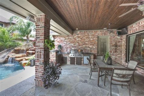 Outdoor Kitchen On Covered Flagstone Patio Includes