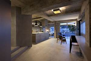 concrete house with raw beauty and an eye for fashion With parquet de lyon