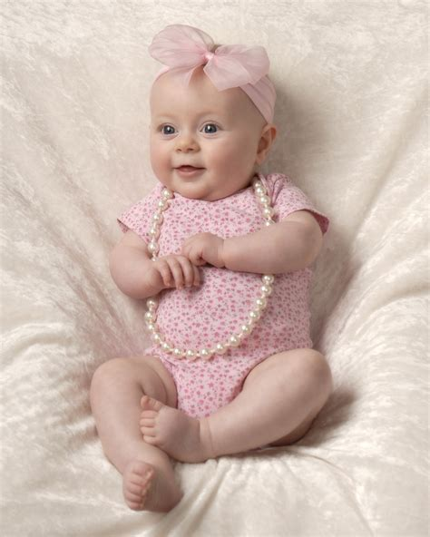 month baby photograph  girl sitting  cleary
