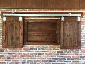 Barn Door Style Outdoor TV Cabinet Remodeling Contractor