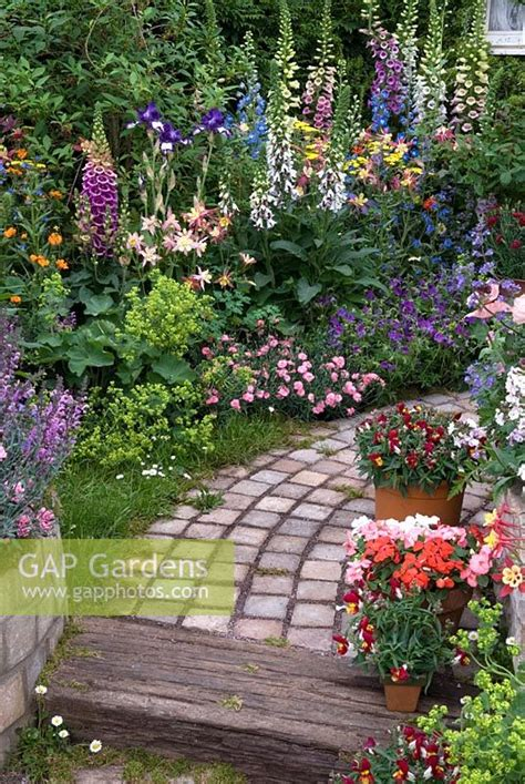 Gap Gardens  Path Through Lush Border And Container