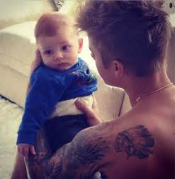 newborn hair bows overloaded justin bieber holding a baby toddler