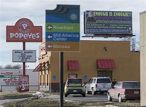 Satirical billboard in Council Bluffs — filled with ...