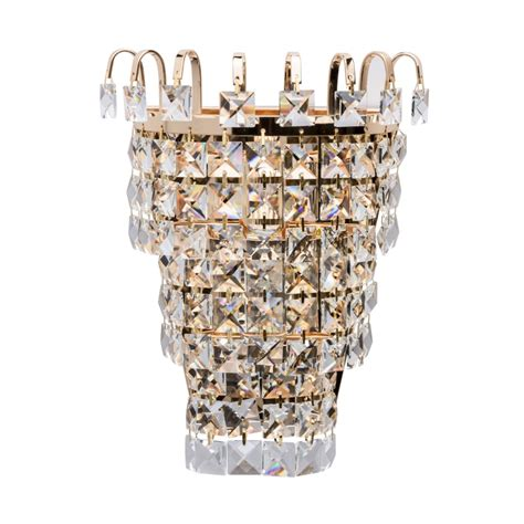 impressive single wall light in gold with crystal clear