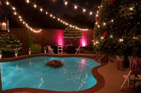 hanging lights around pool set 10 ways lights can turn your yard into an enchanted