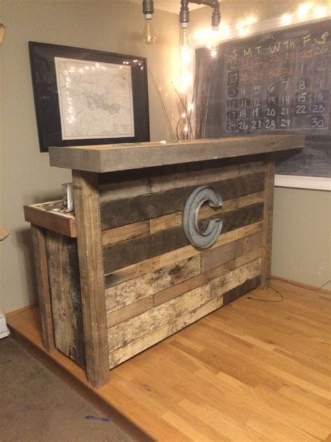Reclaimed wood bar made from pallets.   For the Home in