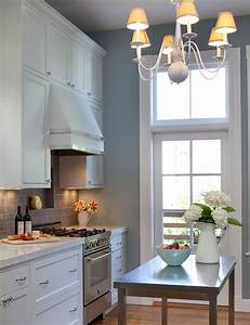 kitchens white kitchen cabinets marble countertops gray With kitchen colors with white cabinets with blue and gray wall art