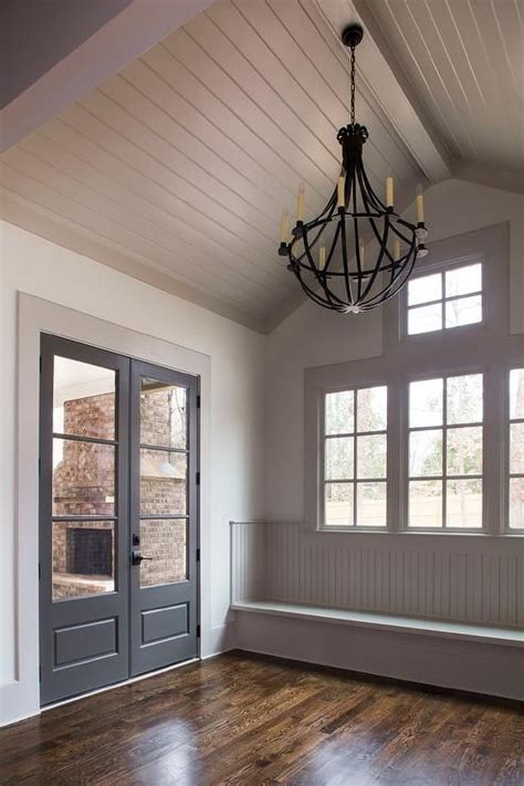 Shiplap Ceiling Pictures by Gray Cottage Mudroom Features A Gray Shiplap Vaulted