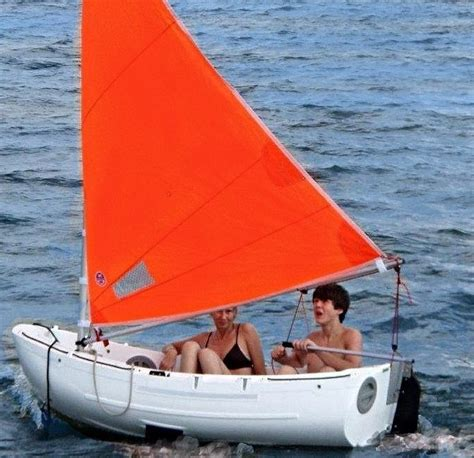 Dinghy And Boat by Dinghy Lifeboat Yacht Tender Sailing Dinghy
